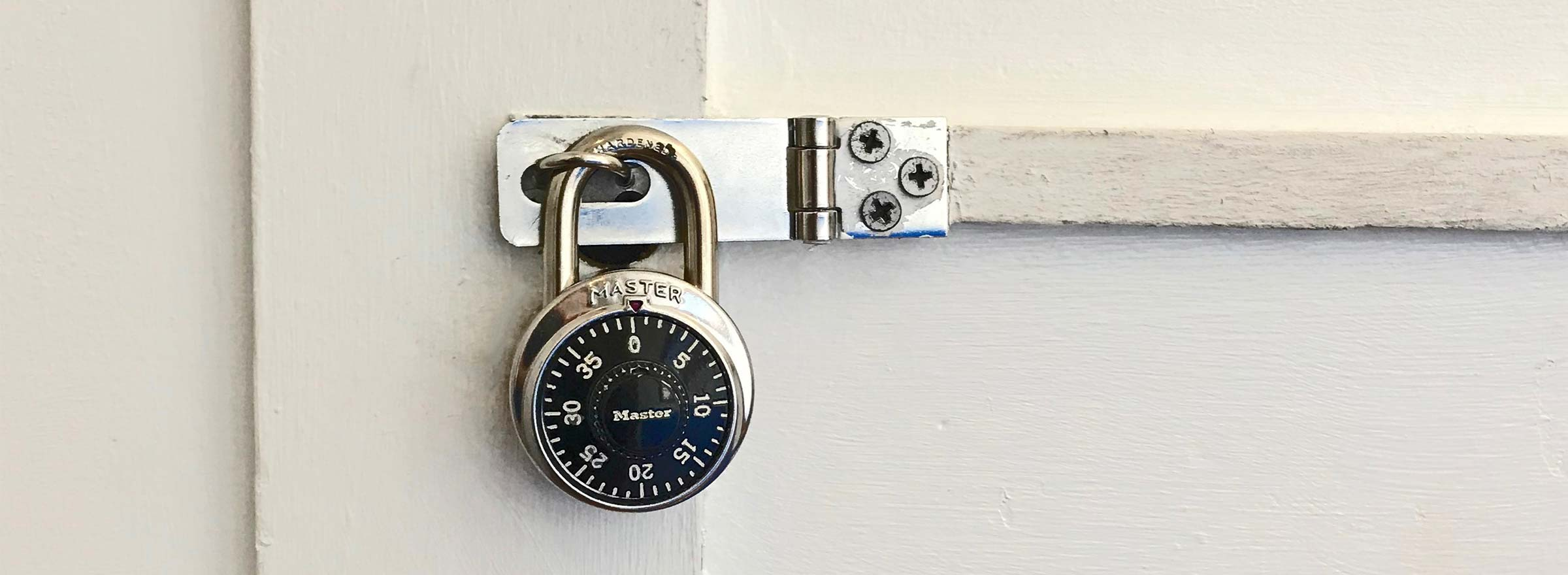 a combination lock securing a door, representing the need for cybersecurity for nonprofits