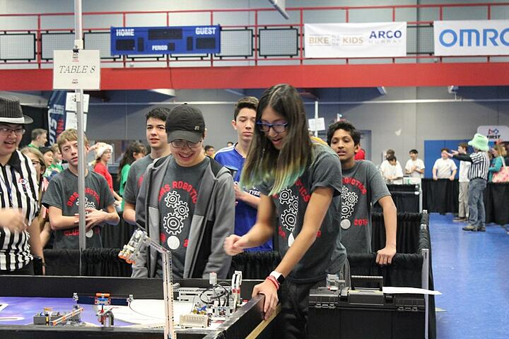 young people at a robotics tournament