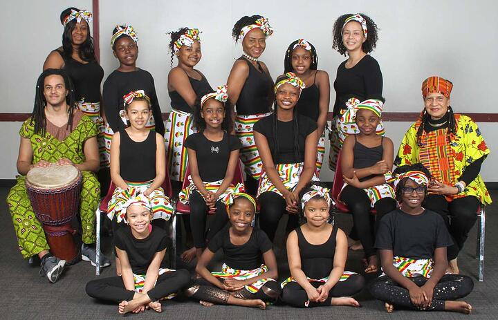A group of African drumming students