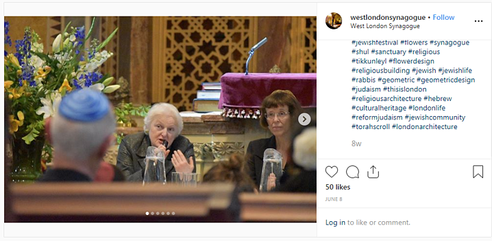 Instagram post showing a panel discussion at a synagogue