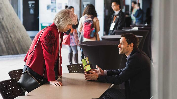 TechSoup CEO Rebecca Masisak chats with an attendee at the Global Network Summit in March 2019