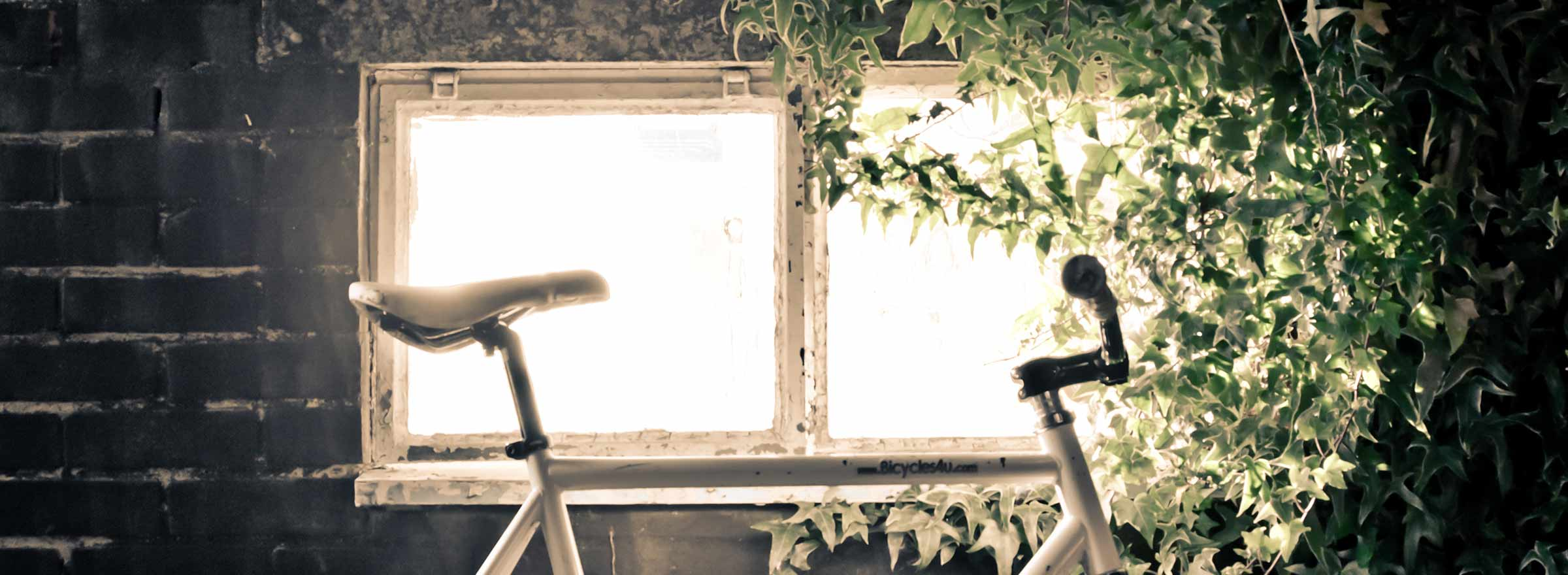 a used bike in front of a brightly light window, representing the good work B!KE is able to do in part because of Intuit QuickBooks