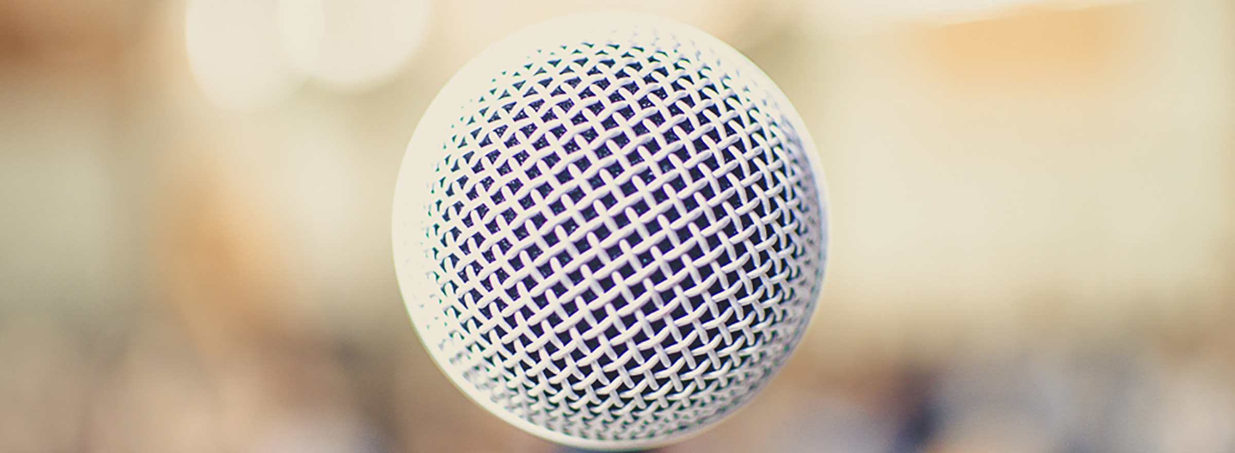 a close-up view of a microphone symbolizing social impact technology panels at sxsw