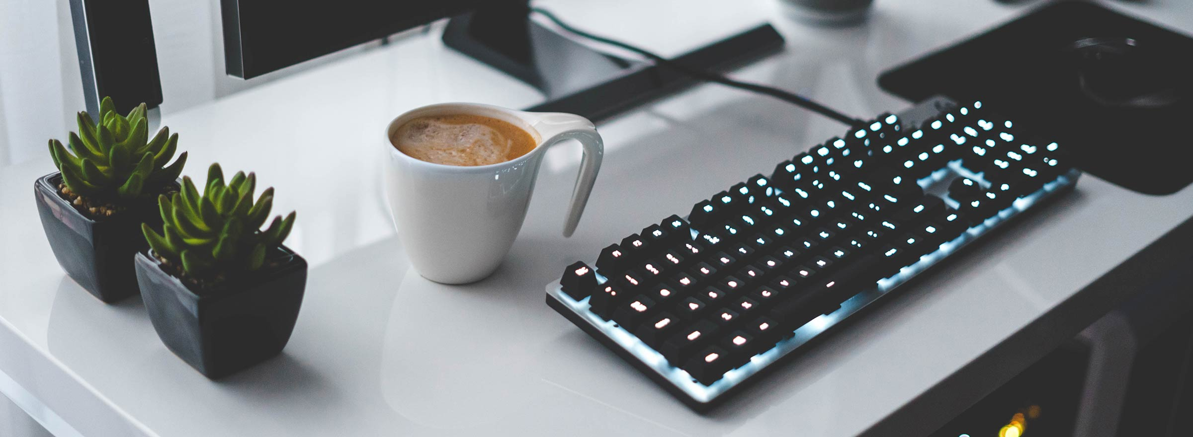 a computer keyboard and a cup of coffee in a nonprofit office
