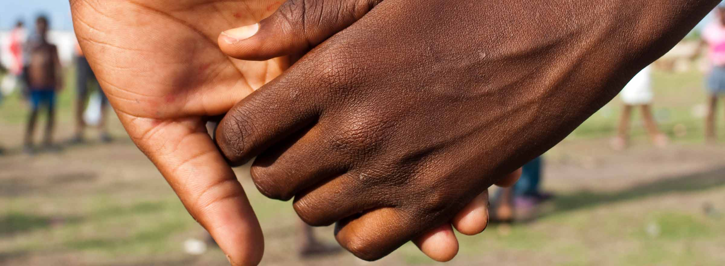 two hands joined together, representing how a nonprofit in Haiti used Intuit QuickBooks to better achieve its mission and build sustainable communities
