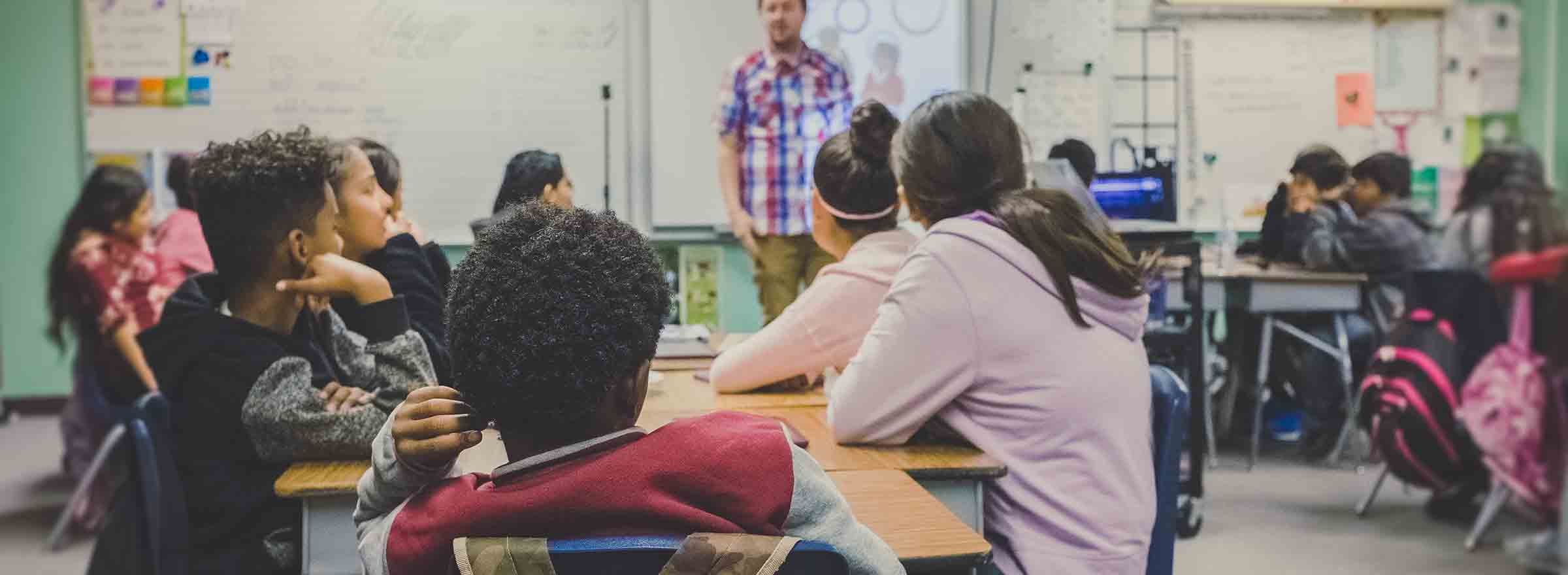 a classroom with diverse students, representing how nonprofits can bridge the digital divide