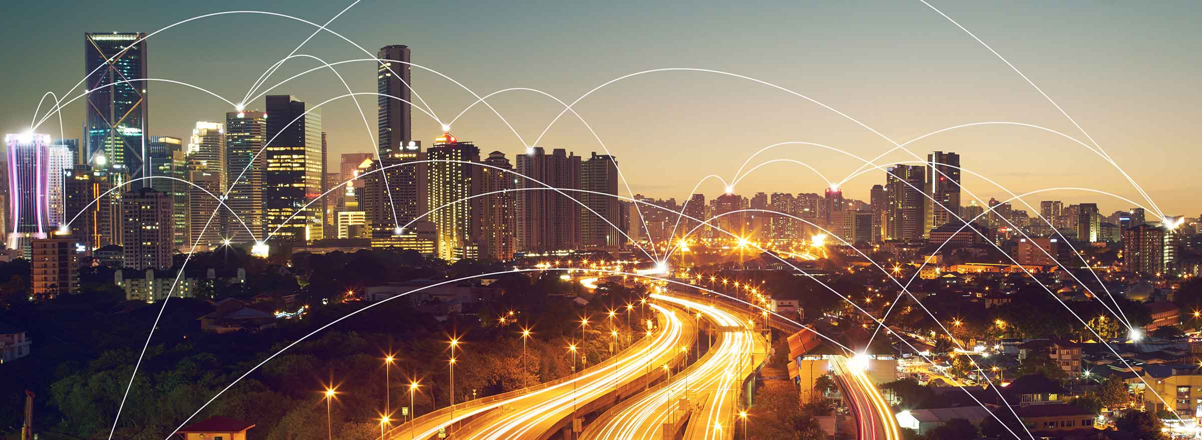 a highway going between skyscrapers with arcs of light connecting buildings, representing the internet and the need to eliminate the digital divide