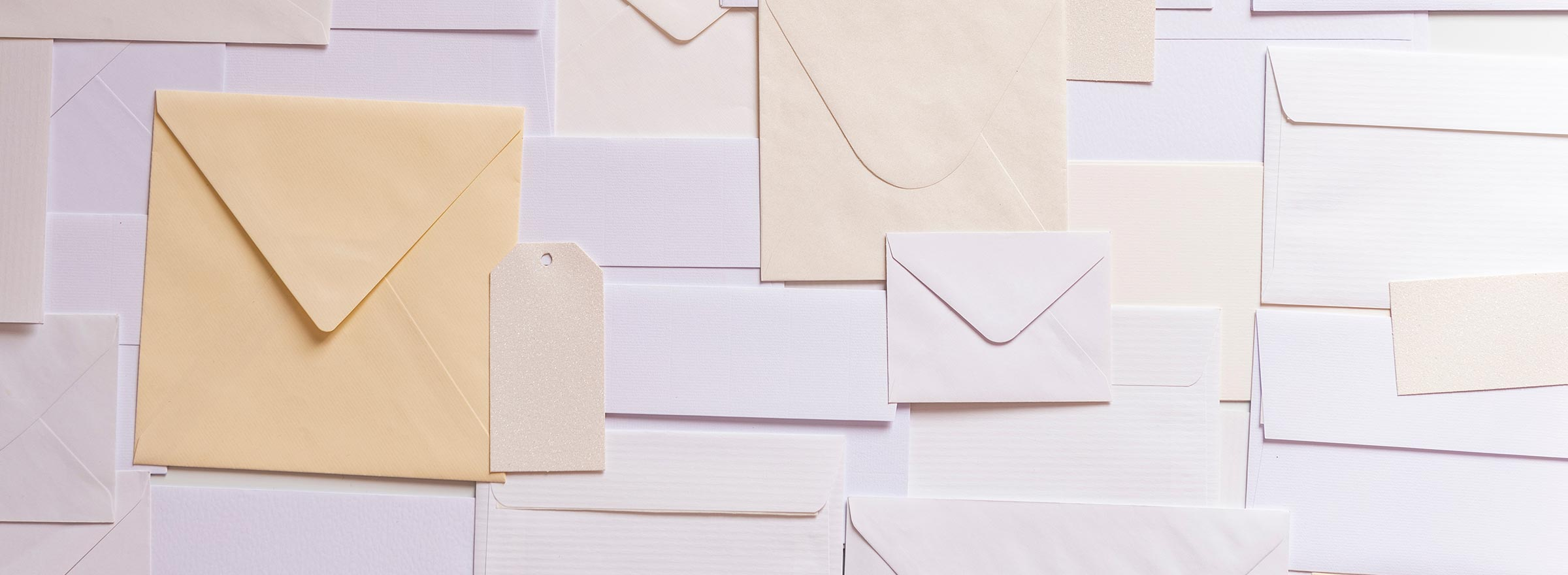 many envelopes of different sizes, representing email marketing for nonprofits