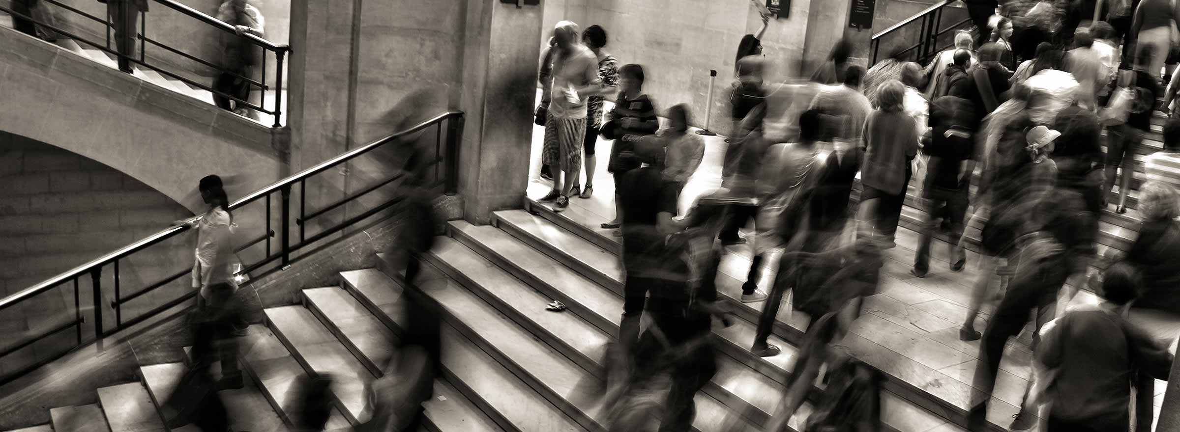 people walking up and down a courthouse staircase, representing how symantec helps a nonprofit stay secure and help human trafficking survivors