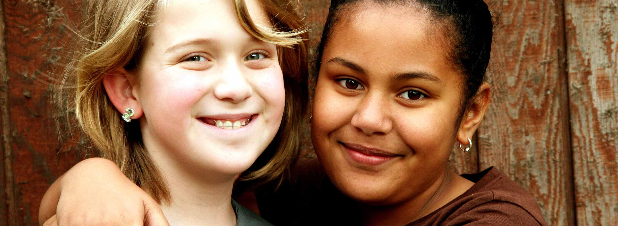 head shot of two girls together