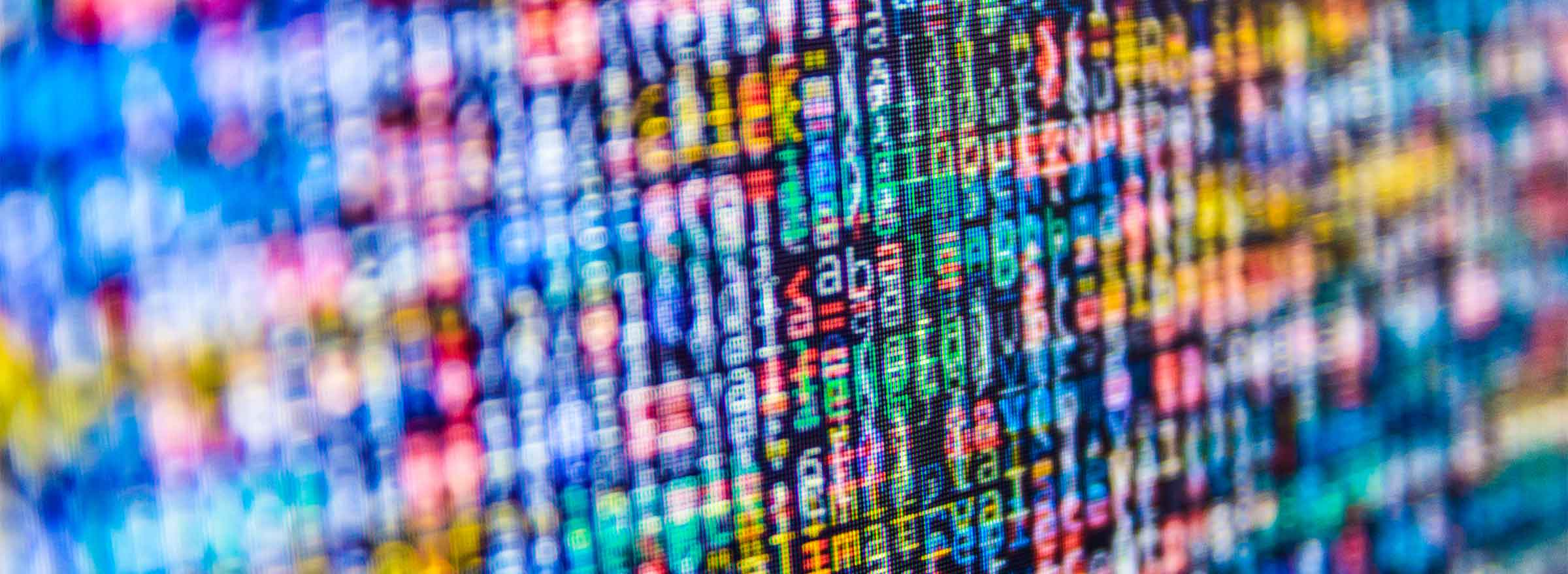 out-of-focus image of computer code in many colors