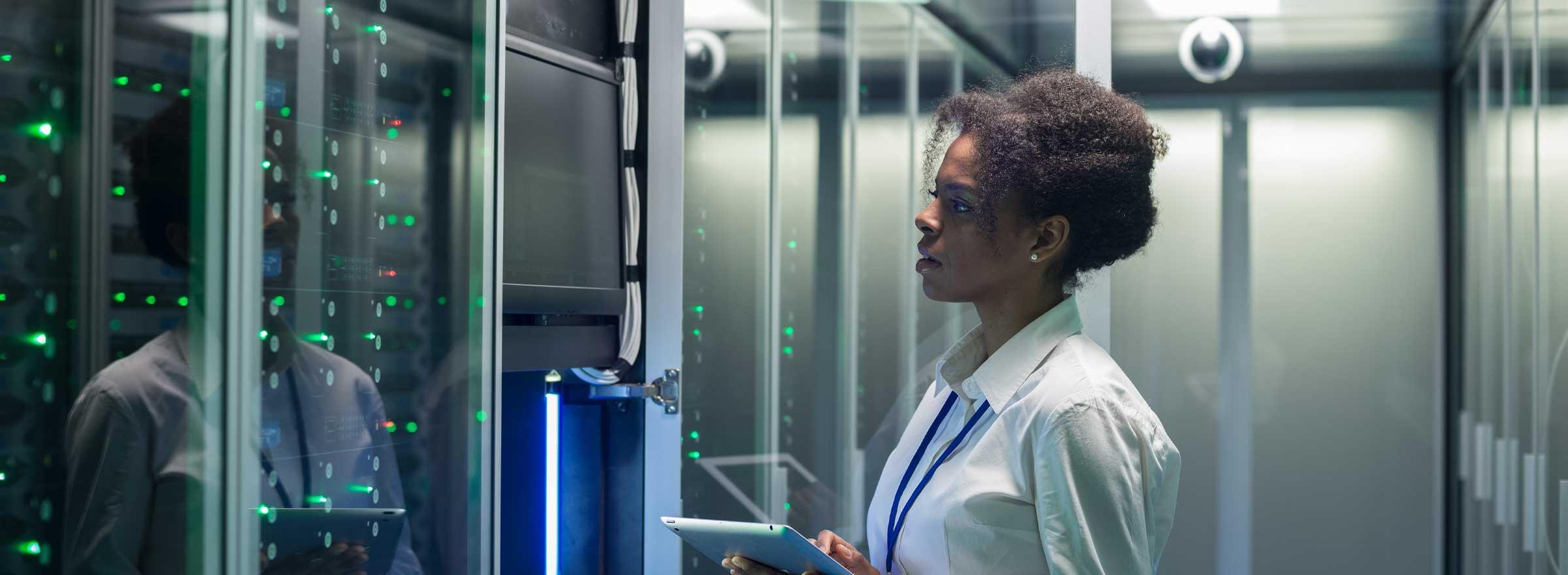 Technician inspecting a rack of servers