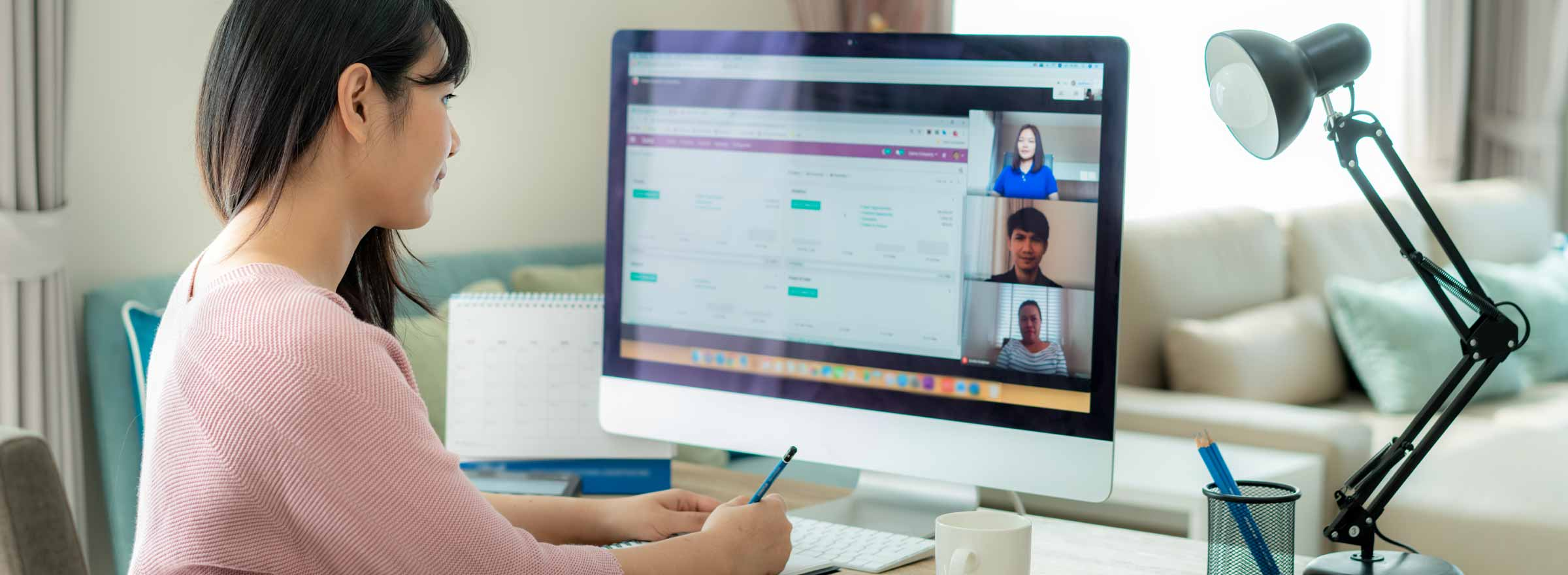 woman on a video call with three other people