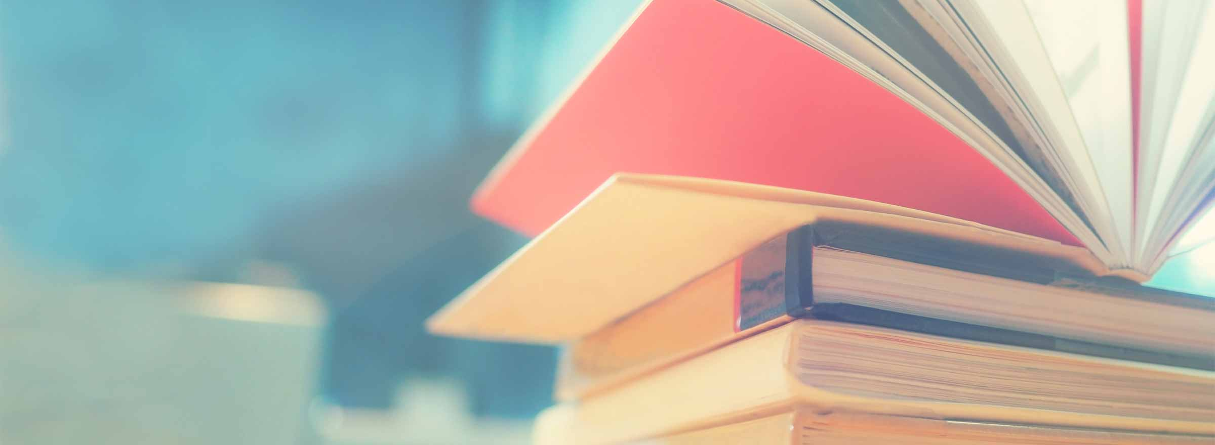 stack of books, the top one open