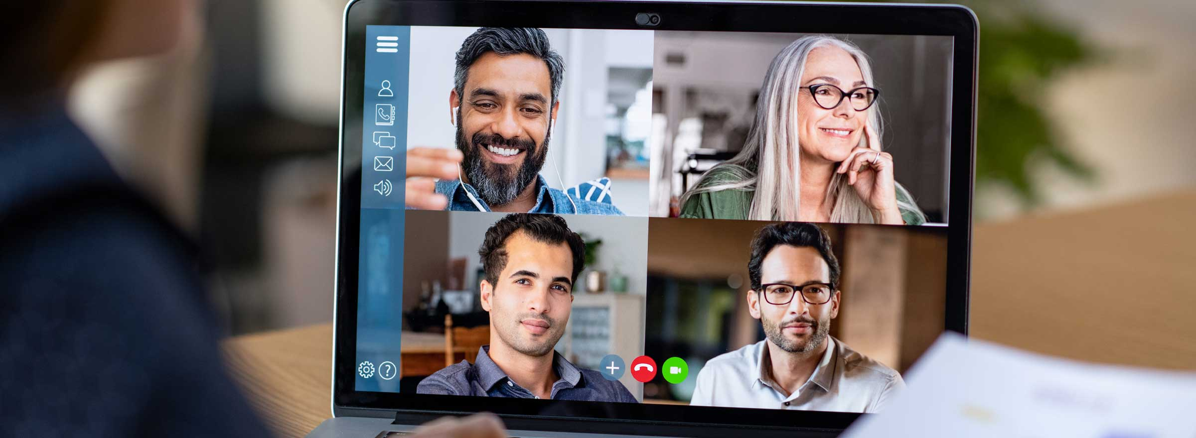 computer screen showing four people in a video conference