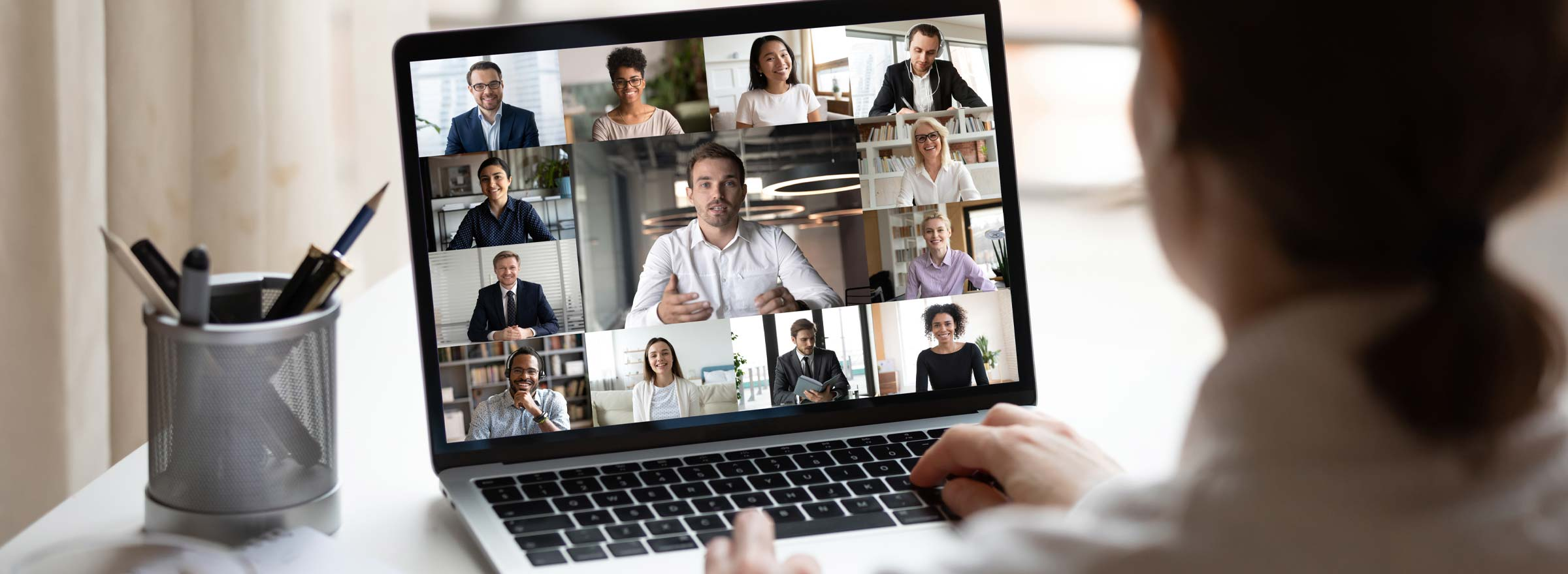 woman having an online video conference with 12 other people