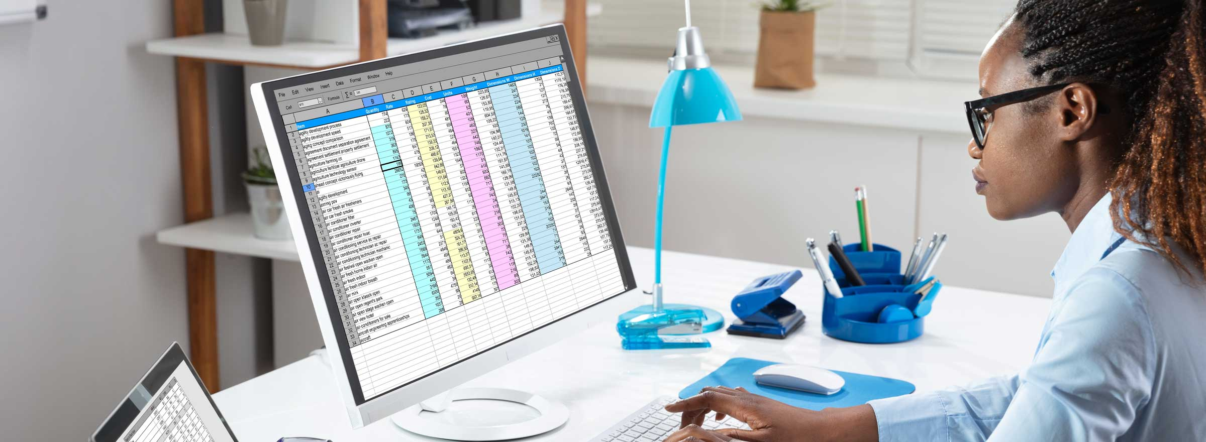 Woman working on a large spreadsheet