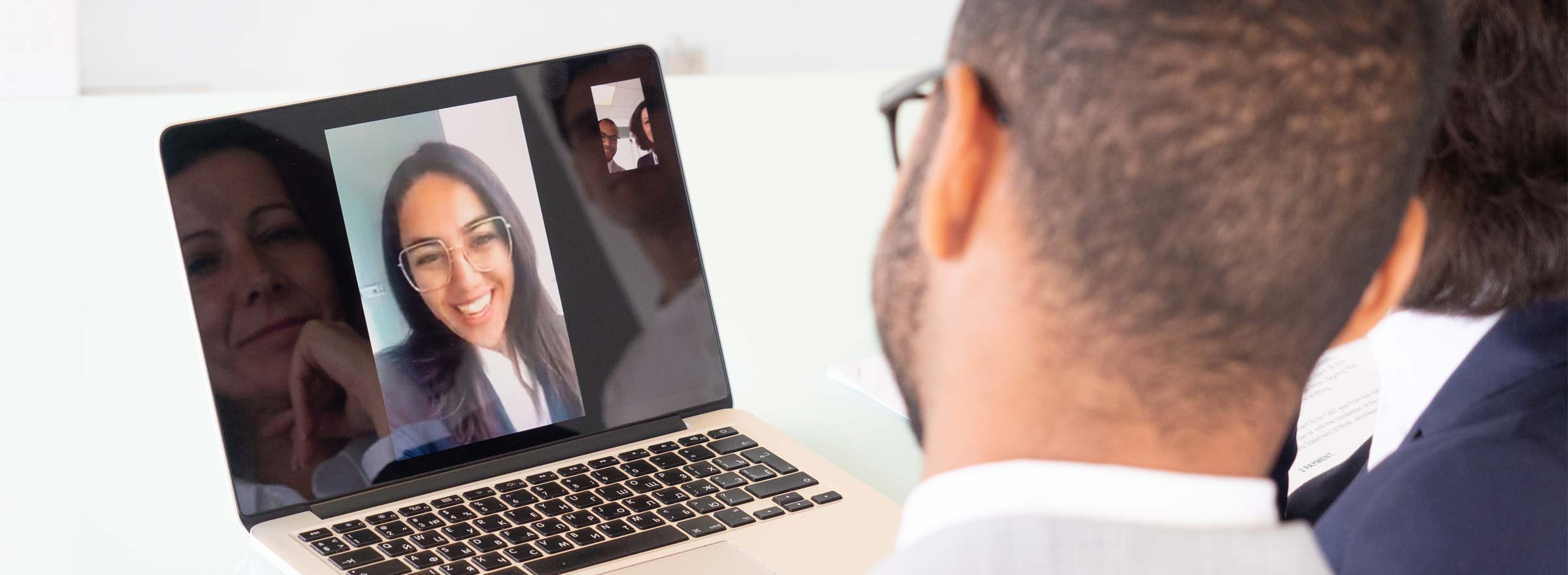 two people having a video conference with a third
