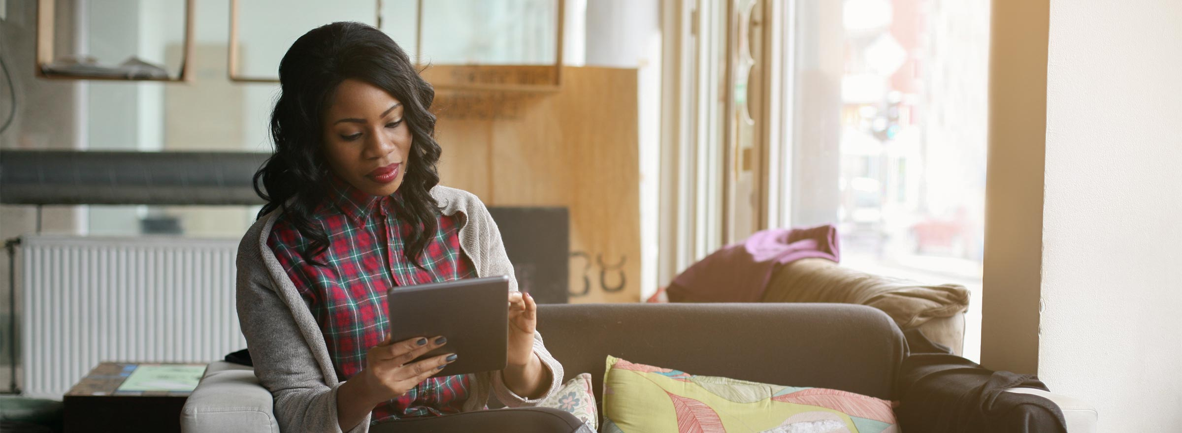 woman using a tablet in a home setting