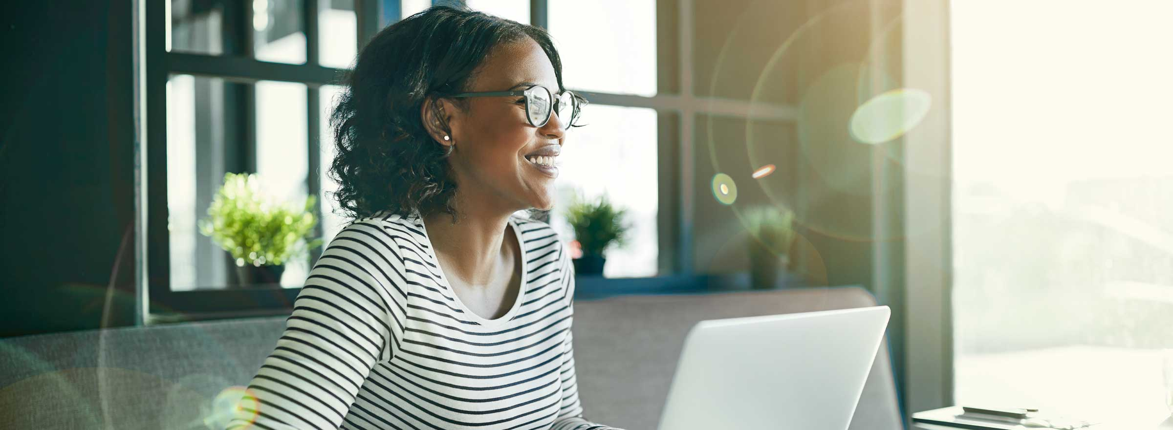 woman sitting at a computer and smiling