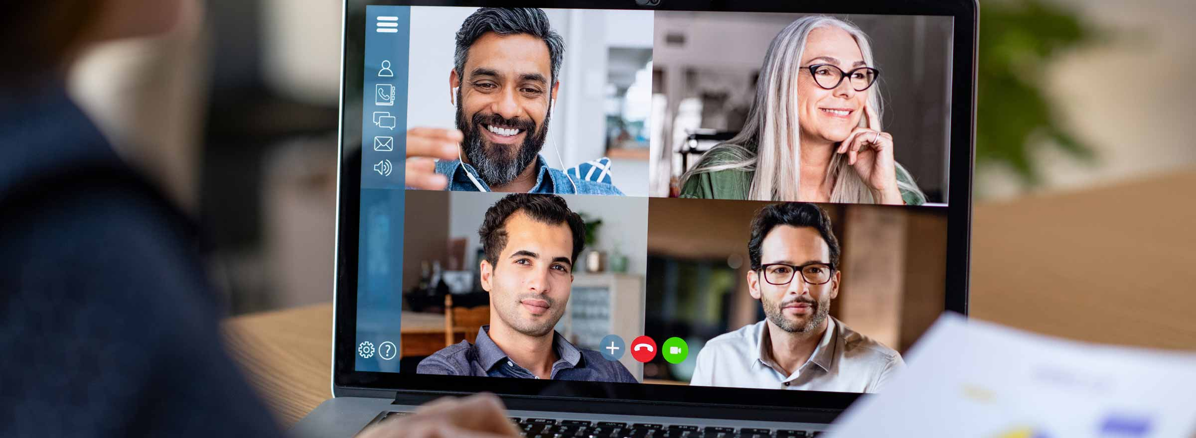 laptop showing four people in video conference
