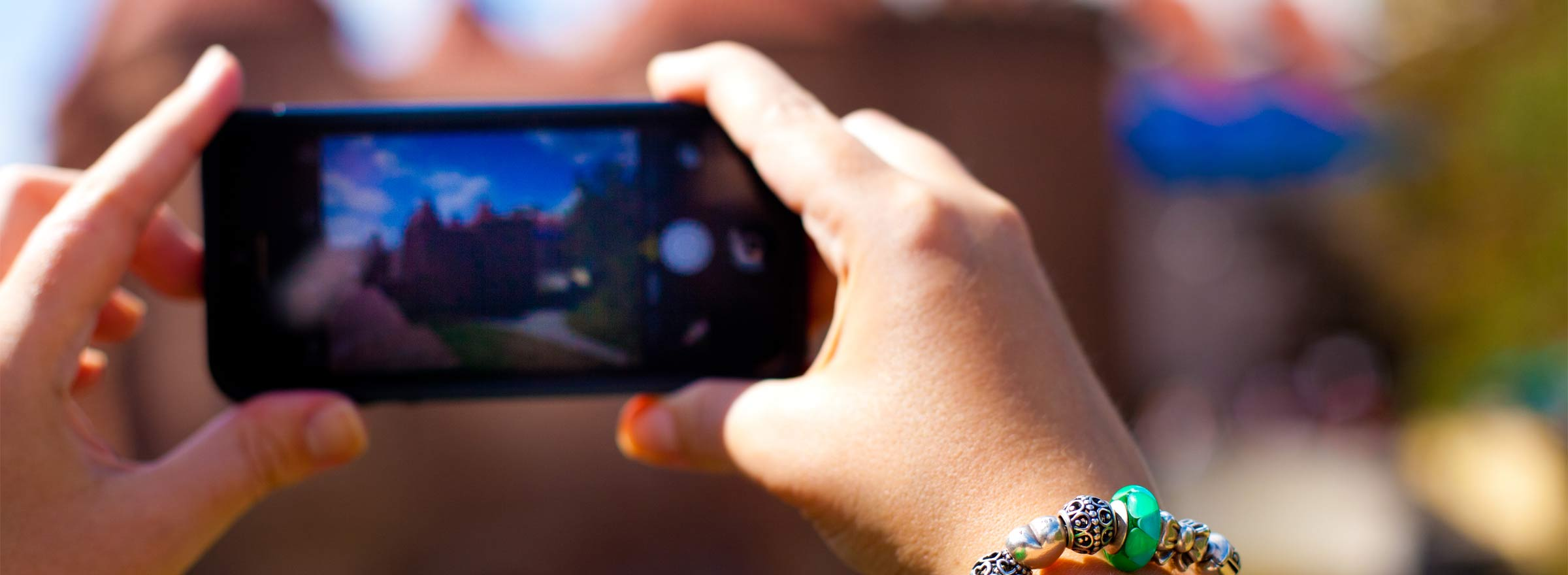 hands of a woman recording a video with a smartphone