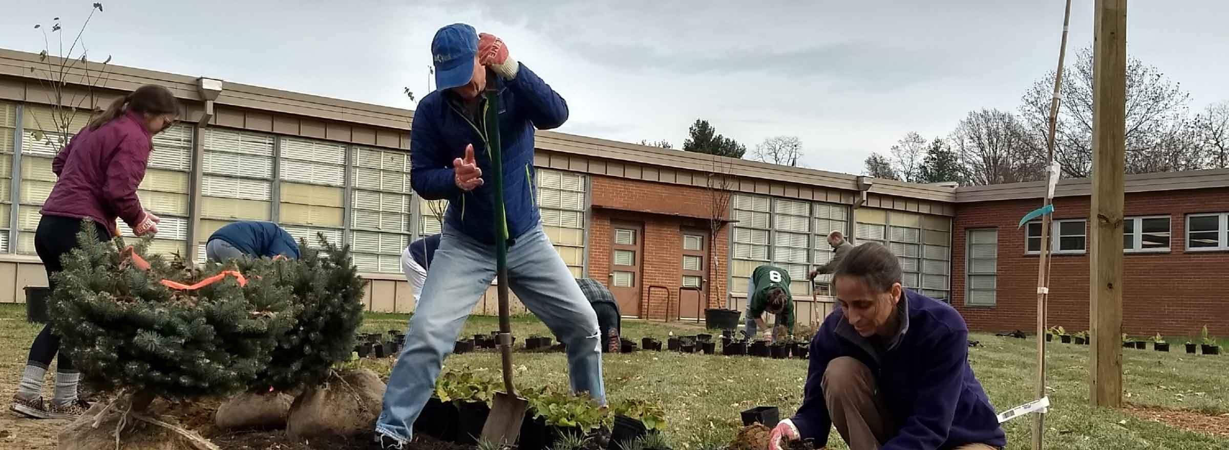 volunteers installing the new garden at Capitol Heights Elementary School