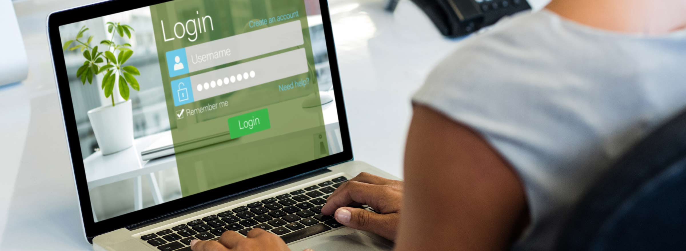 woman looking at a login screen symbolizing improved identity management through Okta for Good