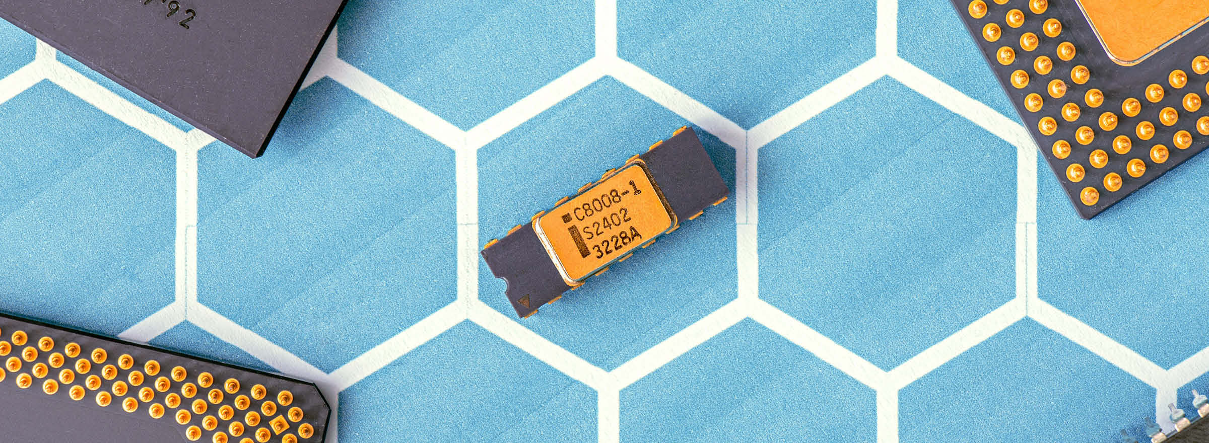 a computer chip resting on top of a hexagonal grid