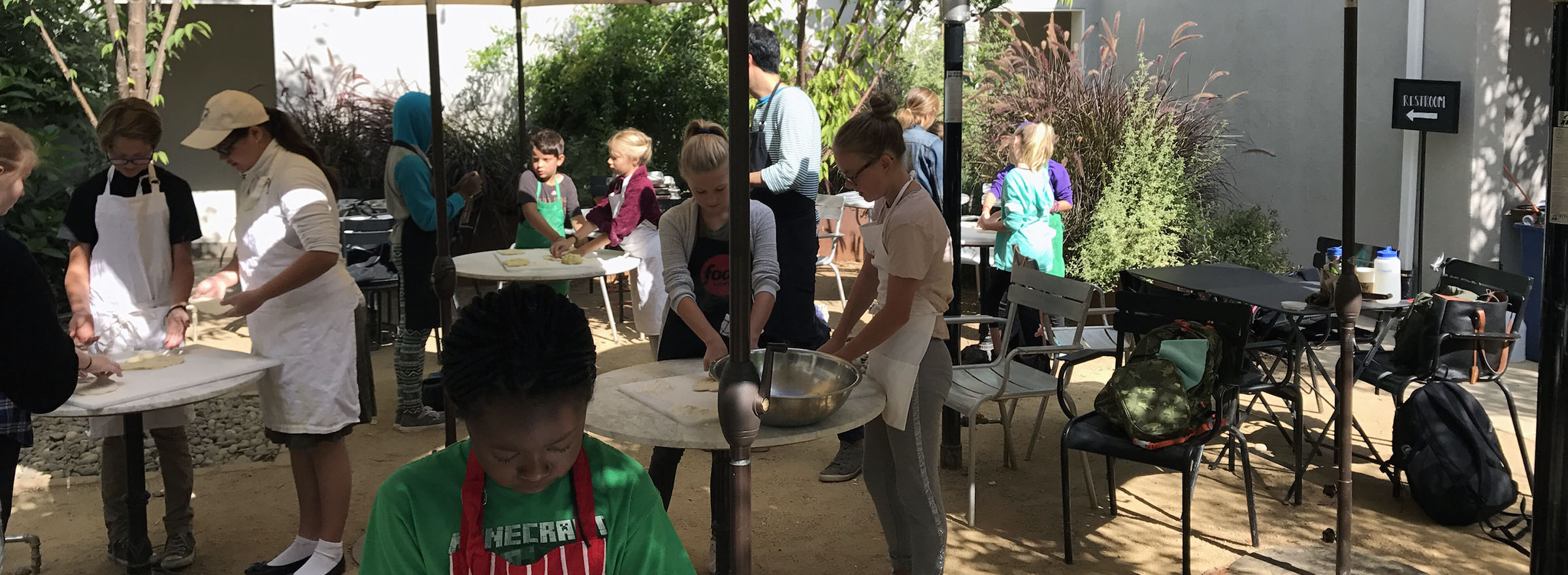 group of kids making dough in a Sprouts Cooking Club class