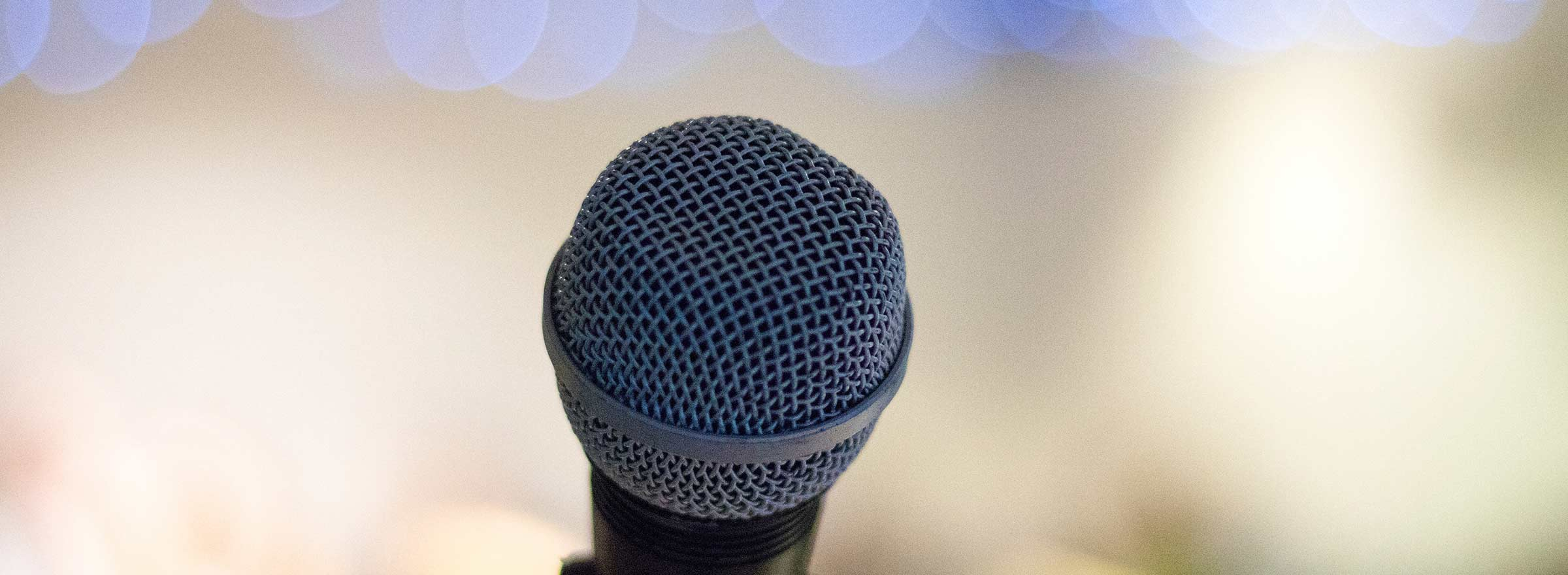 picture of a microphone, representing how a nonprofit used Microsoft Azure to help people with hearing impairments