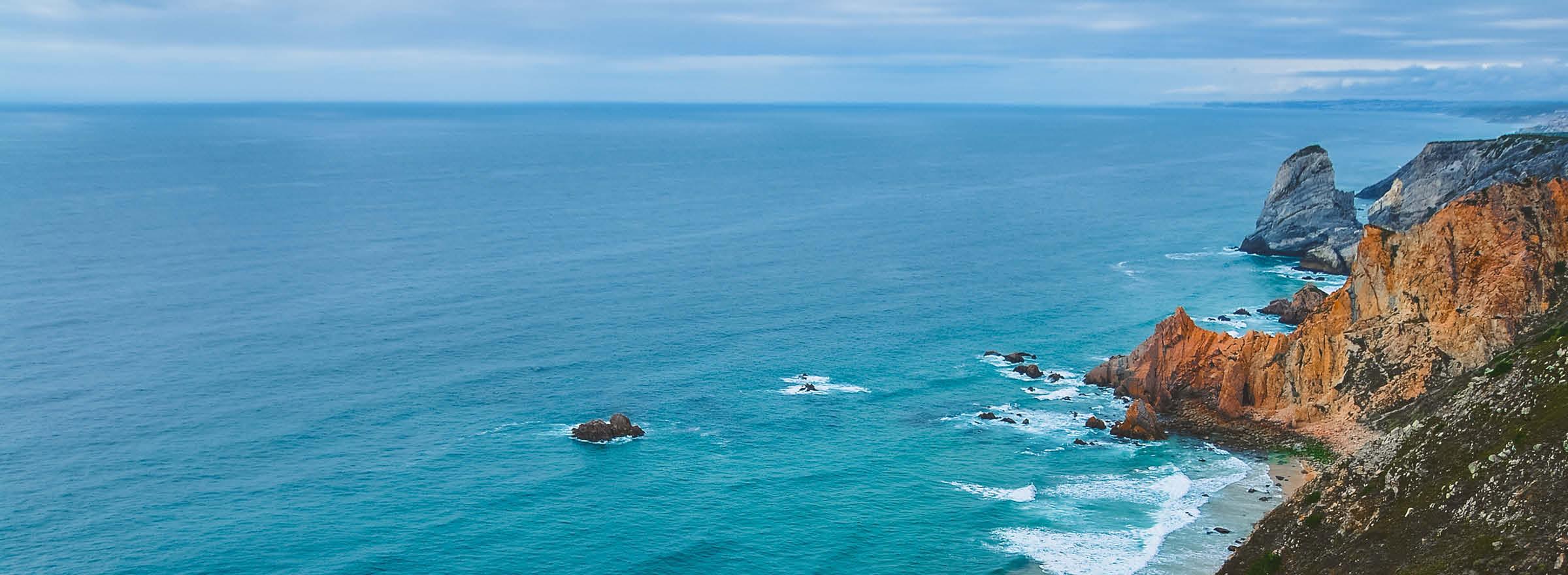 ocean washing up against a rocky coastline