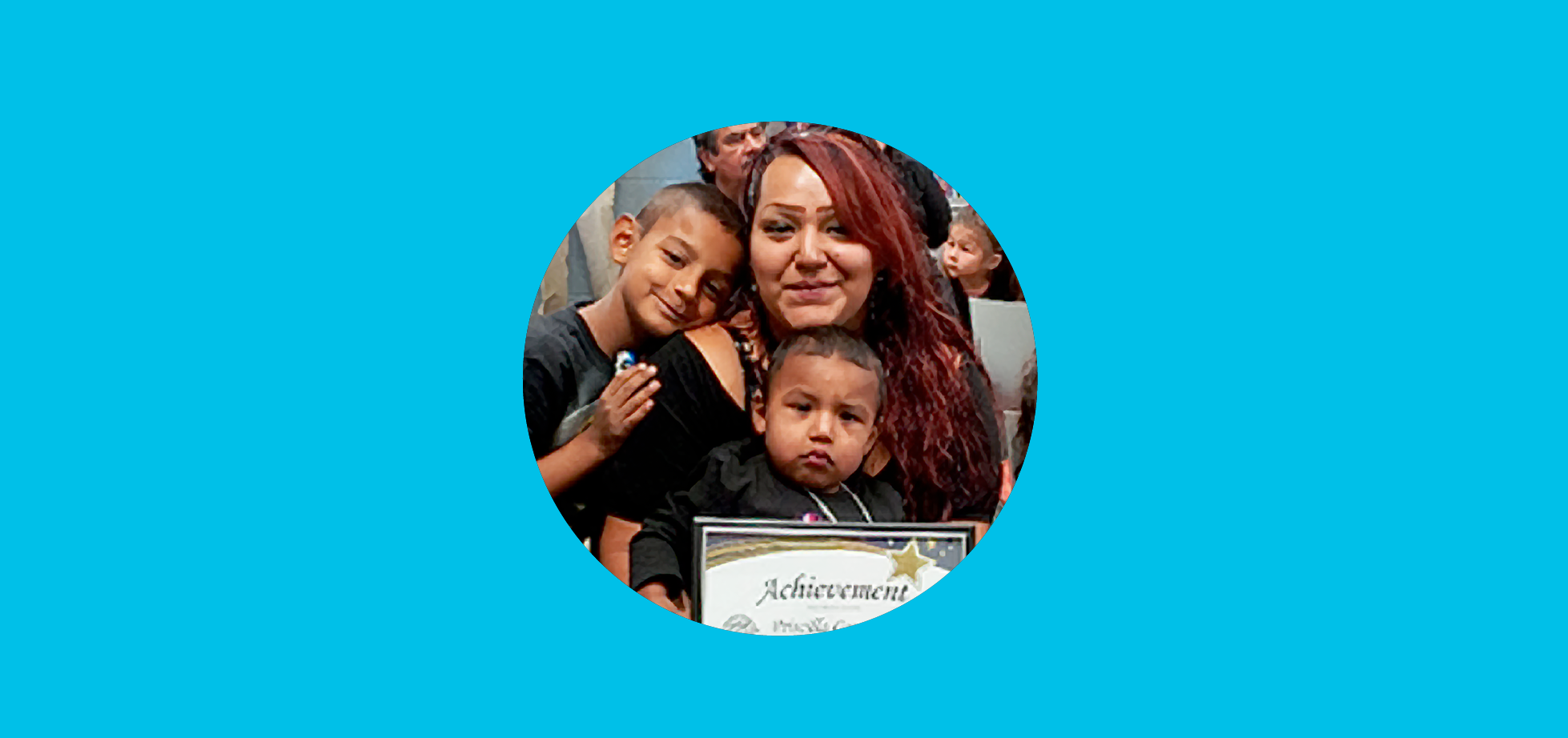 photo of a woman with her children holding her certificate of achievement from Smooth Transitions