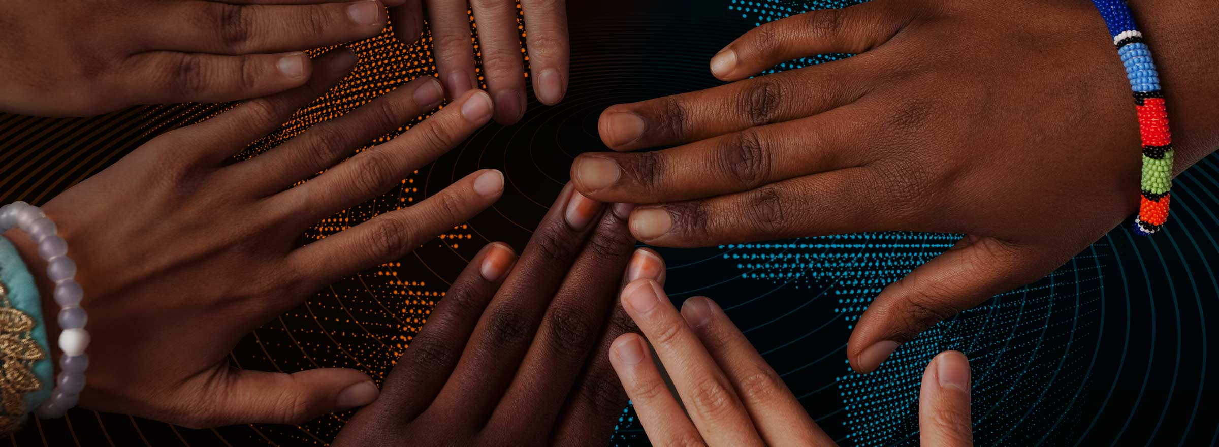 hands of people from many races with fingers outstretched toward each other